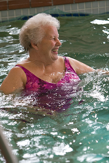 Photo - A resident enjoys the clubhouse pool