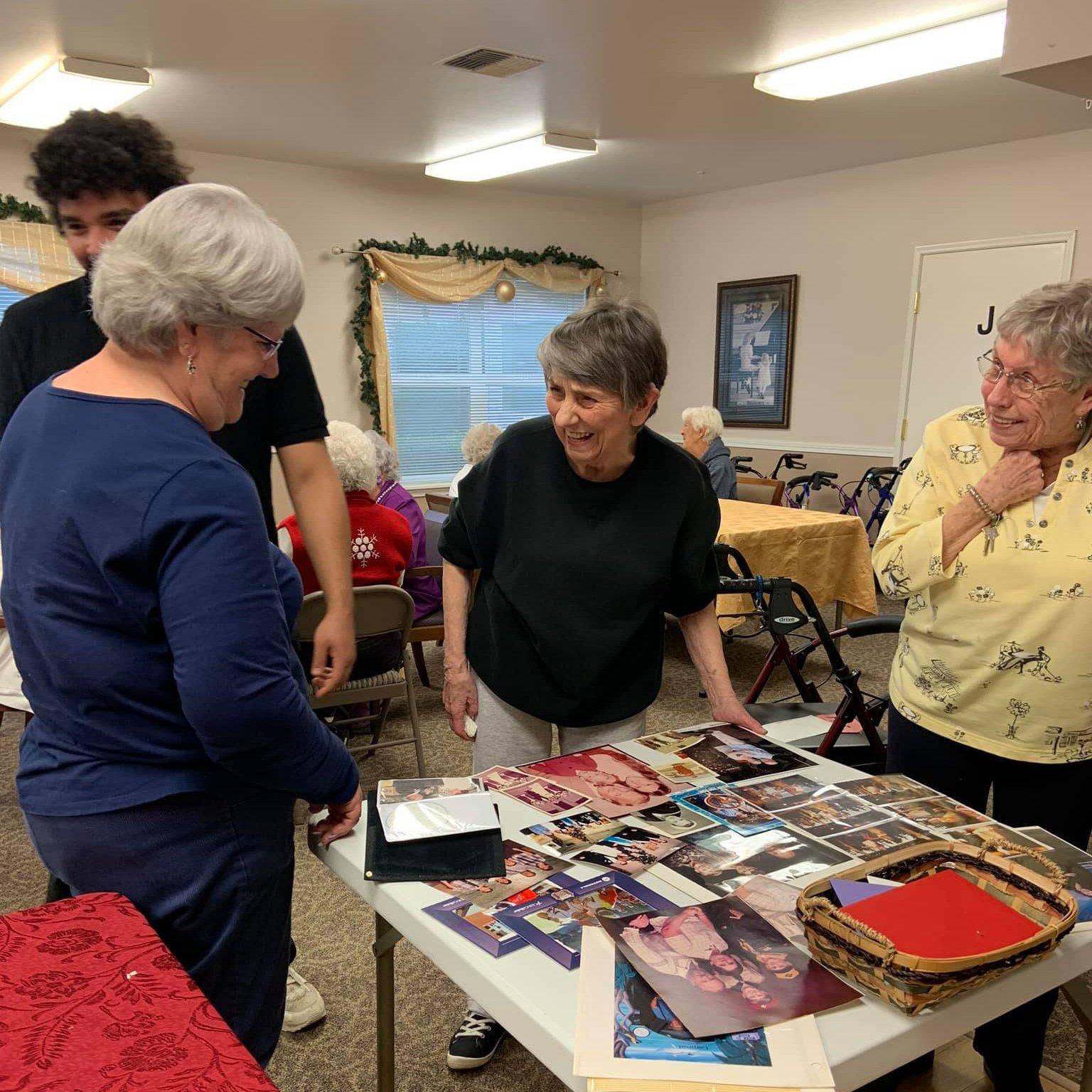 Residents sharing old photos at at Colonial Inn Olympia