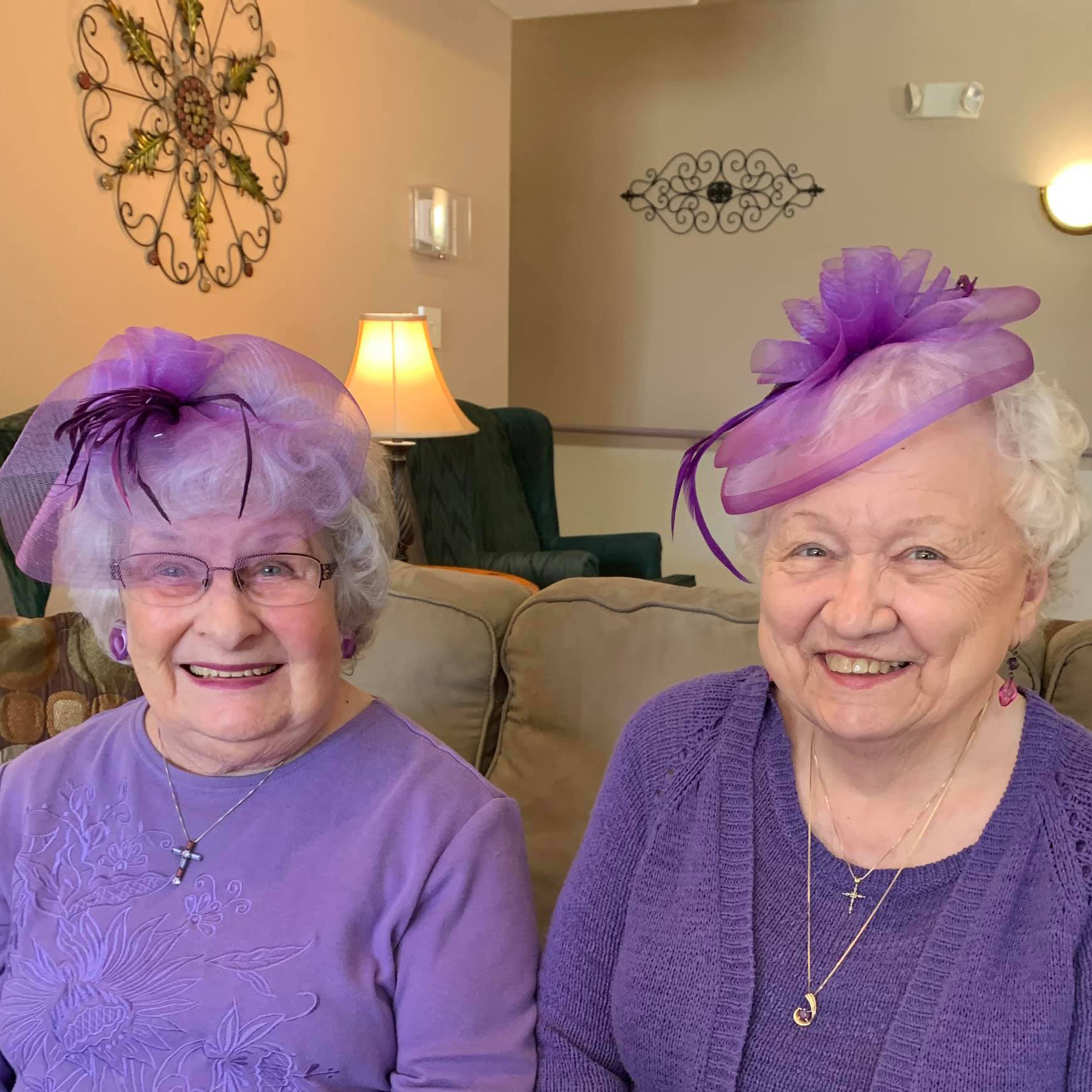 Two beautiful women in purple hats at Colonial Inn Olympia